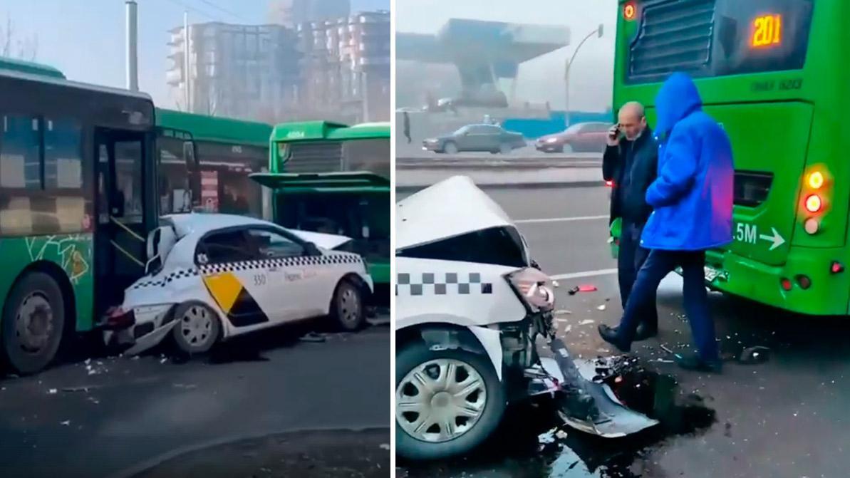 Geely расплющило между двумя автобусами в Алматы