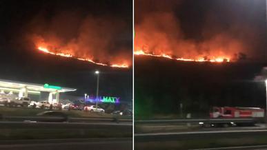 Едва не загорелась АЗС на ВОАД из-за пожара на склоне горы в Алматы