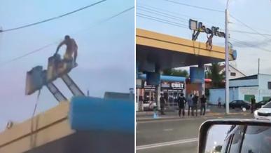 Неадекватный мужчина залез на крышу автозаправки в Алматы