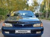 Toyota Carina E 1997 года за 2 650 000 тг. в Алматы – фото 5