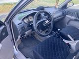 Mazda 323 2002 года за 2 350 000 тг. в Павлодар – фото 4