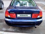 Mitsubishi Carisma 1996 года за 498 992 тг. в Караганда – фото 2