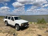 Nissan Patrol 1991 года за 950 000 тг. в Жезказган – фото 4