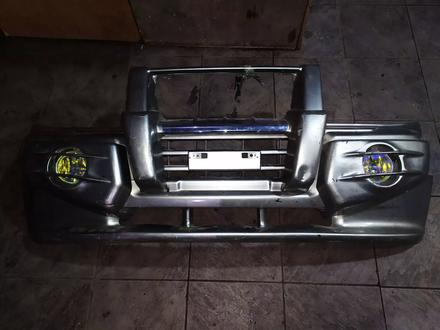 Передний бампер на Mitsubishi Pajero III за 120 тг. в Алматы