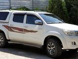 Toyota Hilux 2013 года за 8 950 000 тг. в Алматы