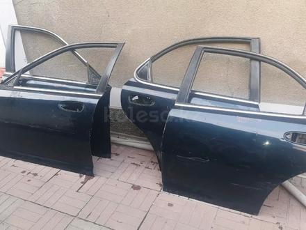 Двери Мазда кседокс 6 за 8 000 тг. в Алматы