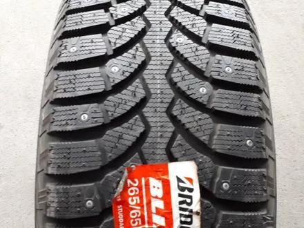 Шины Bridgestone 265/65/r17 Spike-01 за 56 000 тг. в Алматы – фото 2