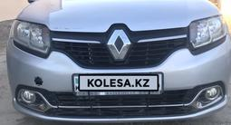 Renault Logan 2015 года за 2 700 000 тг. в Атырау – фото 2