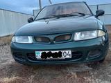Mitsubishi Carisma 1998 года за 980 000 тг. в Актобе – фото 3