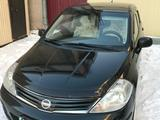 Nissan Tiida 2010 года за 4 300 000 тг. в Караганда – фото 2