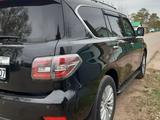 Nissan Patrol 2014 года за 14 300 000 тг. в Уральск – фото 2