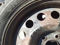 Диск с резиной на BMW за 10 000 тг. в Караганда