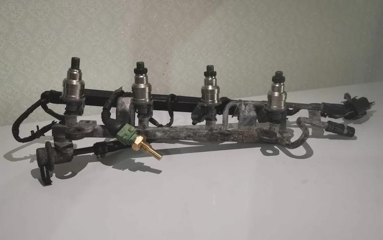 Топливная рампа с форсунками мазда 323 323F за 15 000 тг. в Алматы