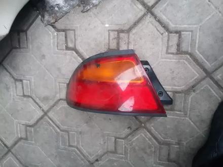 На Mazda 323 — Astina — Lantis фонарь Мазда 323… за 8 000 тг. в Алматы – фото 2