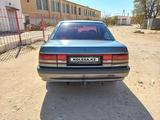 Mazda 626 1991 года за 700 000 тг. в Жанаозен – фото 5