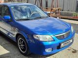 Mazda 323 2001 года за 2 100 000 тг. в Кызылорда – фото 3