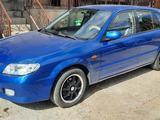 Mazda 323 2001 года за 2 100 000 тг. в Кызылорда – фото 4