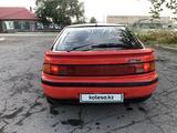 Mazda 323 1992 года за 480 000 тг. в Караганда – фото 2