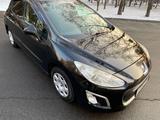 Peugeot 308 2012 года за 2 900 000 тг. в Алматы