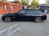 BMW 750 2009 года за 7 350 000 тг. в Алматы