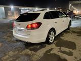 Chevrolet Cruze 2013 года за 4 177 564 тг. в Караганда – фото 2