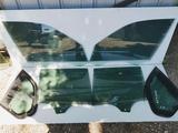 Стекло передней двери E70 за 10 000 тг. в Алматы