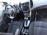 Chevrolet Aveo 2014 года за 3 100 000 тг. в Жанаозен – фото 2