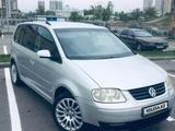 Volkswagen Touran 2003 года за 2 900 000 тг. в Алматы