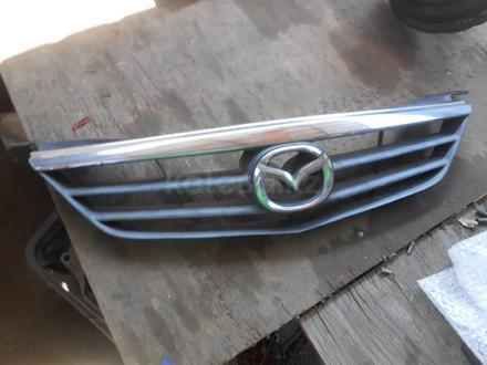 Решетка радиатора Mazda 626 птичка рестайл 2000-02 за 10 000 тг. в Алматы