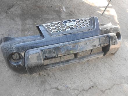 Бампер передний с решоткой дорестайл Nissan X-Trail за 65 000 тг. в Алматы