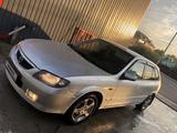 Mazda 323 2003 года за 2 400 000 тг. в Алматы – фото 2