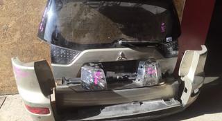 Дверь багажника Mitsubishi Outlander за 1 000 тг. в Караганда
