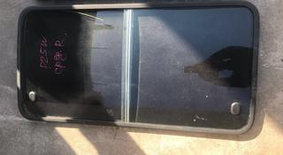 На Мицубиси Дэлика «Квадрат» стекло боковое с раздвижными форточками за 40 000 тг. в Алматы