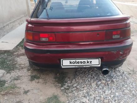 Mazda 323 1994 года за 450 000 тг. в Шымкент – фото 7