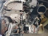На мицубиси делика двигатель с кпп за 100 000 тг. в Атырау