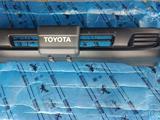 Бампер передний на Toyota Land Cruiser 105 за 90 000 тг. в Караганда