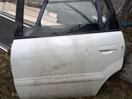Дверь задняя левая за 7 000 тг. в Алматы