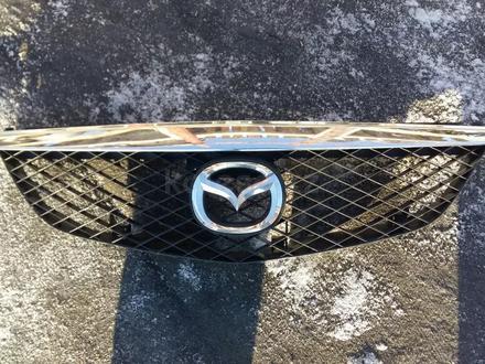 Решетка решётка радиатора дорестайлинг Mazda Premacy за 15 000 тг. в Семей