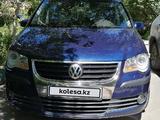 Volkswagen Touran 2007 года за 3 600 000 тг. в Караганда – фото 2