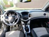 Chevrolet Cruze 2012 года за 1 850 000 тг. в Актобе – фото 2