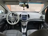 Chevrolet Aveo 2014 года за 3 500 000 тг. в Актобе – фото 5