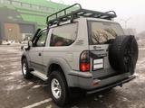 Toyota Land Cruiser Prado 1999 года за 4 800 000 тг. в Алматы – фото 4