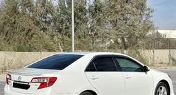 Toyota Camry 2014 года за 8 600 000 тг. в Жанаозен – фото 2