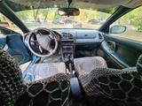 Mazda 323 1994 года за 900 000 тг. в Уральск – фото 4