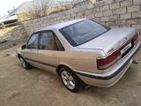 Mazda 626 1991 года за 550 000 тг. в Жанаозен – фото 3