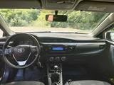 Toyota Corolla 2014 года за 5 600 000 тг. в Караганда – фото 2
