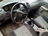 Mazda 323 2002 года за 1 200 000 тг. в Караганда – фото 5