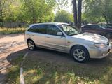 Mazda 323 2002 года за 2 100 000 тг. в Караганда – фото 2