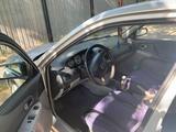Mazda 323 2002 года за 2 100 000 тг. в Караганда – фото 4