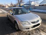 Mazda 323 2002 года за 2 100 000 тг. в Талдыкорган – фото 4